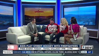 Kids play street hockey with firefighters