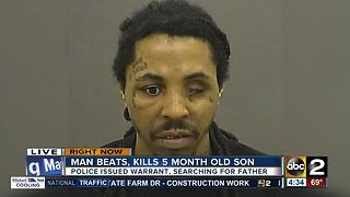 Police looking for father charged with murdering infant son - Video