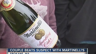 Woman uses bottle of Martinelli's to stop robber - Video