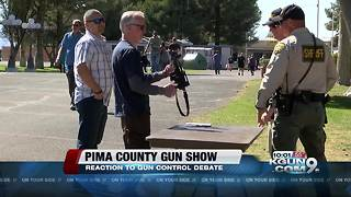 People react to gun debate at a gun show in Pima County - Video