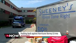 Local gym pushes bus to raise funds for hurricane relief - Video