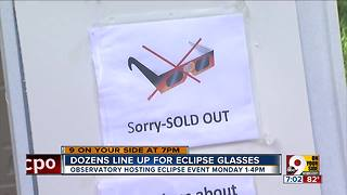 Dozens line up for eclipse glasses - Video