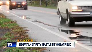 Sidewalk safety battle in Wheatfield - Video