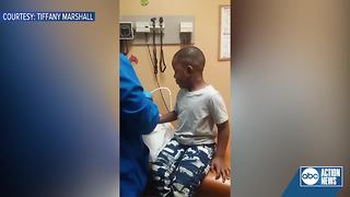 Video of St. Petersburg medical assistant calming boy down during his shots goes viral - Video