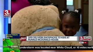 Omaha Police deliver backpacks to kids at Ronald McDonald House - Video