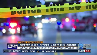Suspect killed, officer injured in shootout