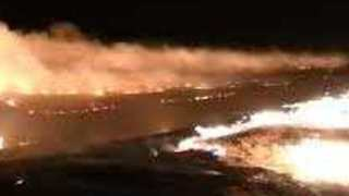 Texas Firefighters Perform Burnout of Large Wildfire - Video