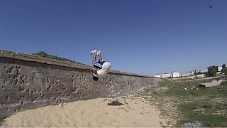 What A Sand Up Guy! Athlete Attempts Double Backflip Off Wall But Faceplants Sandy Floor