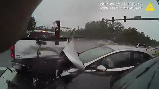 Dramatic video shows truck crashing into officer already at the scene of an accident - Video