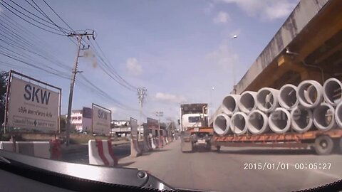 Concrete pipe falls off truck nearly crushing drivers on busy road in Thailand