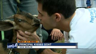 New Berlin principal locks lips with a goat for a cause - Video