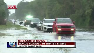 Roads flooded Friday morning in Jupiter Farms - Video