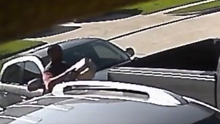 Postal Worker Caught on Camera Leaving Parcel on Customer's Pickup Truck - Video