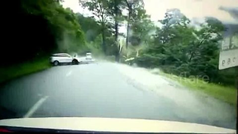 Dramatic footage shows large boulder rolling down hill and smashing car in southeast Tibet