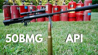 50BMG API VS 200 Pounds of Fire Extinguishers!