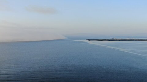 Drone captures fog rolling in at Galway Bay in Ireland