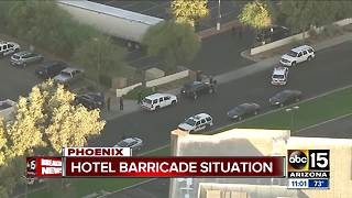 Police working barricade situation at hotel near I-17 and Peoria - Video