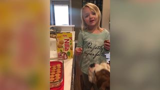 Dog Interrupts Little Girl's Banana Pudding Recipe - Video