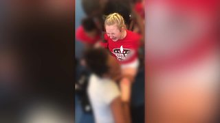 Denver HS staff on leave after cheerleader video - Video