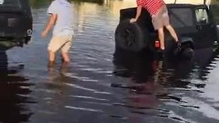 Cars getting towed out of flooded areas in Fort Myers on Island park Rd - Video