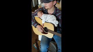 Dad Puts Baby Down For A Nap In A Special Spot - His Guitar!