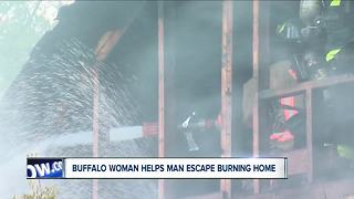 Buffalo woman helps man escape burning home