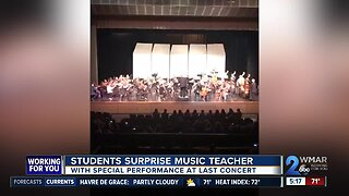 Students surprise music teacher with special performance at final concert