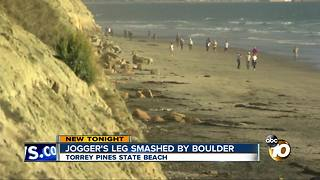 Jogger's leg smashed by boulder - Video
