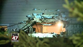 Man hurt after crashing SUV into house - Video