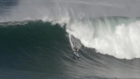 Surfers ride season's first big swell hours before Leslie makes landfall