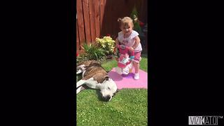 Little girl and her dog share unbreakable bond - Video