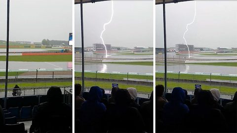 Lightning fast! Shocking moment bolt of lightning strikes middle of silverstone race track