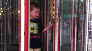 Hilarious Boy Crashes Into A Mirror In Mirror Maze - Video