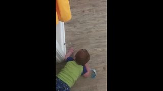 Too cute - baby loves the doorstop spring - Video