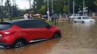 Cars Drive Through Flooded Streets in Daejeon, South Korea