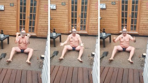Prankster dad wearing tiny Speedos dons snorkel and recreates Peter Andre's 'Mysterious Girl' video in pouring rain