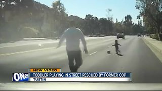 Dashcam video shows toddler playing in street rescued by former cop