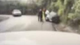Heroic police officer captured on camera saving woman's life on blind curve