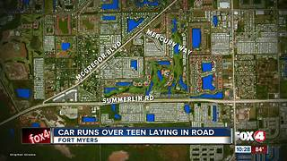 Car Runs Over Teen Laying in Road - Video