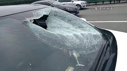 Flying panel smashes into car through windscreen, killing passenger