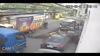 Lorry knocks over tree which falls onto passing woman - Video