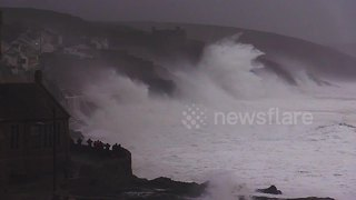 Huge swells and crashing waves in Cornwall as villagers look on - Video