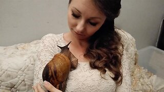 Woman Enjoys Cuddles With Pet Giant African Snail