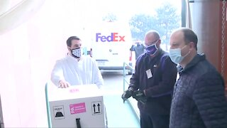Gov. Jared Polis receives Colorado's first shipment of COVID-19 vaccine