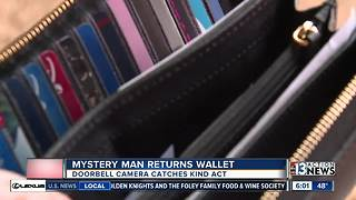 Mystery man returns lost wallet, saves Christmas - Video