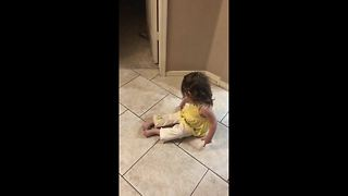 Cute toddler throws tantrum after faking falling down during game of catch - Video