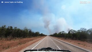 Driver captures dust devil forming on the road