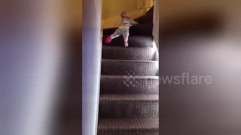 Baby takes the fast route down the stairs