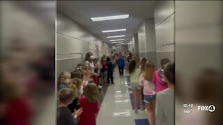 Students line halls to celebrate lunch lady's new citizenship