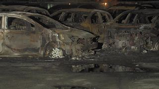 26 cars catch fire after power lines fall - Video
